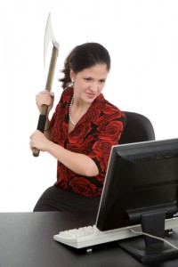 woman threatening computer with axe